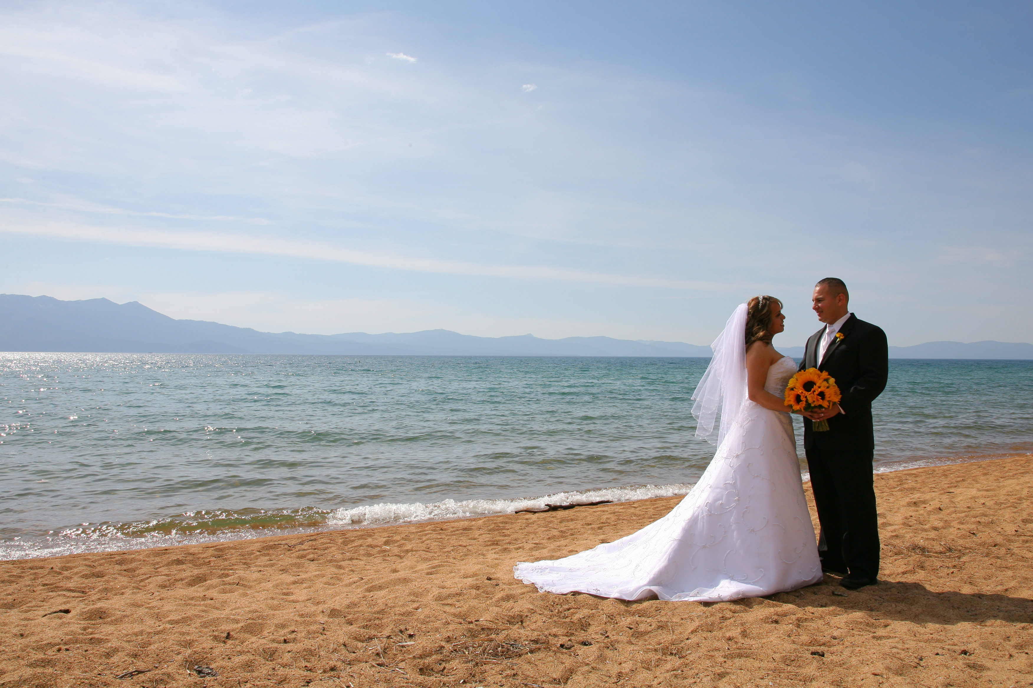 Bride and groom on the beach.
